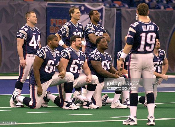 Tom Brady the starting quarterback of the New England Patriots poses for a photograph with teammates in the field at the Superdome in New Orleans...