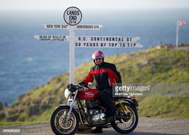 Tom Bray on May 11 2014 in Land's End England Royal Enfield motorcycle riders took part in the 'Top to Tip' sprint ride to mark the 50th anniversary...