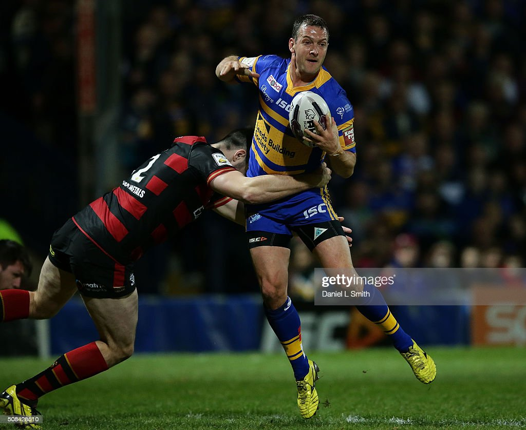 Tom Briscoe of Leeds Rhinos is tackled by Jordan Cox of Warrington Wolves during the First Utility Super League opening match between Leeds Rhinos and Warrington Wolves at Headingley Carnegie Stadium on February 4, 2016 in Leeds, England.