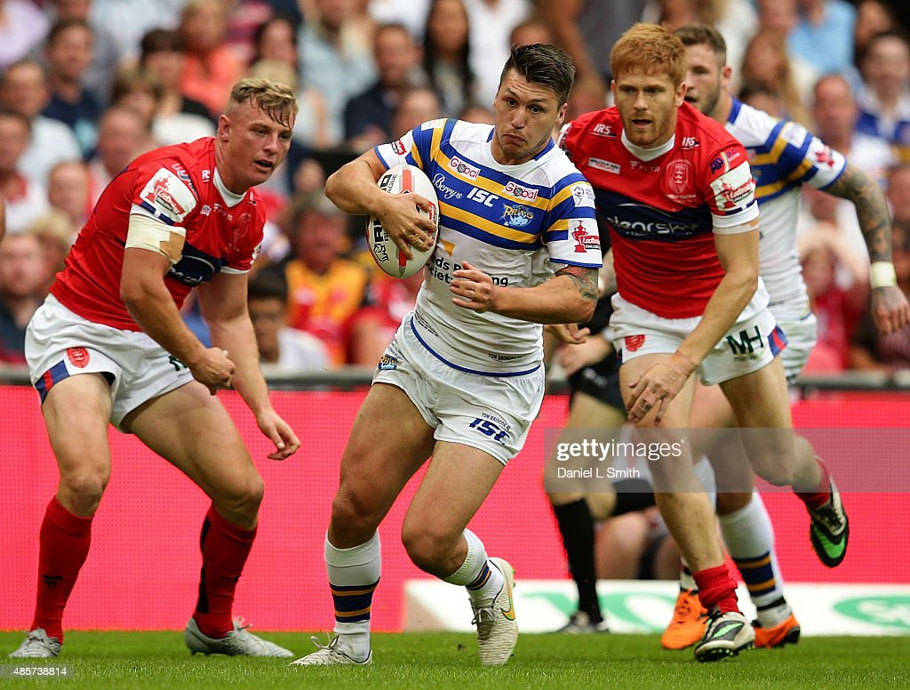 Tom Briscoe of Leeds Rhinos pushes through Hull KR during the Ladbrokes Challenge Cup Final between Leeds Rhinos and Hull KR at Wembley Stadium on August 29, 2015 in London, England.