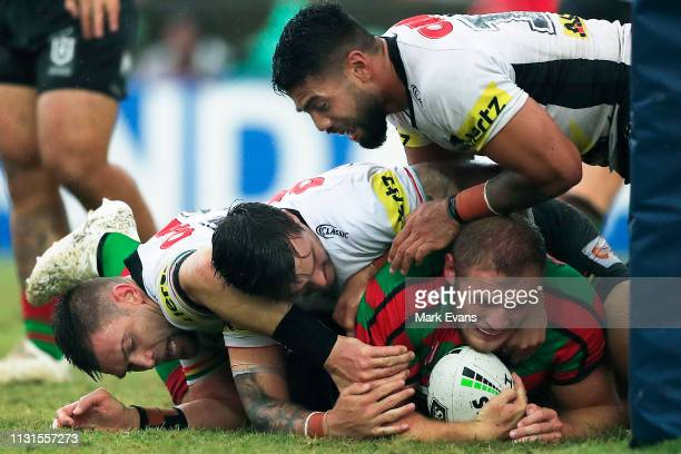 Tom Burgess is tackled during the NRL trial match between the South Sydney Rabbitohs and the Penrith Panthers at Redfern Oval on February 23 2019 in...