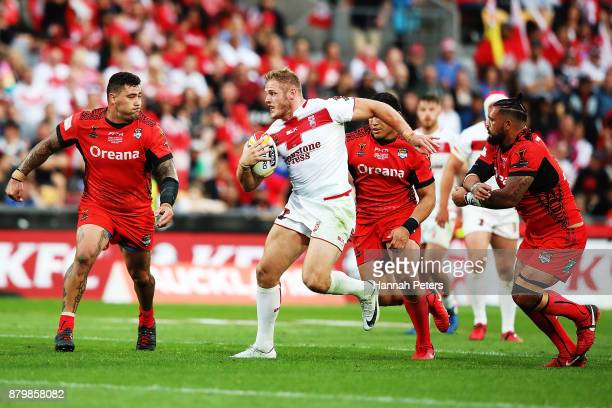 Tom Burgess of England charges forward during the 2017 Rugby League World Cup Semi Final match between Tonga and England at Mt Smart Stadium on...