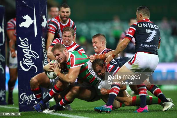Tom Burgess of the Rabbitohs attempts to score a try during the round one NRL match between the Sydney Roosters and the South Sydney Rabbitohs at...