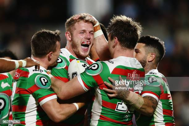 Tom Burgess of the Rabbitohs celebrates with teammates after scoring a try during the round 12 NRL match between the New Zealand Warriors and the...