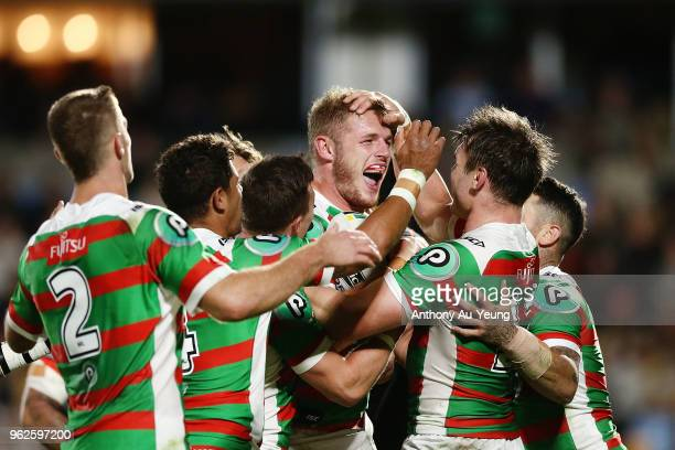 Tom Burgess of the Rabbitohs is congratulated by teammates after scoring a try during the round 12 NRL match between the New Zealand Warriors and the...