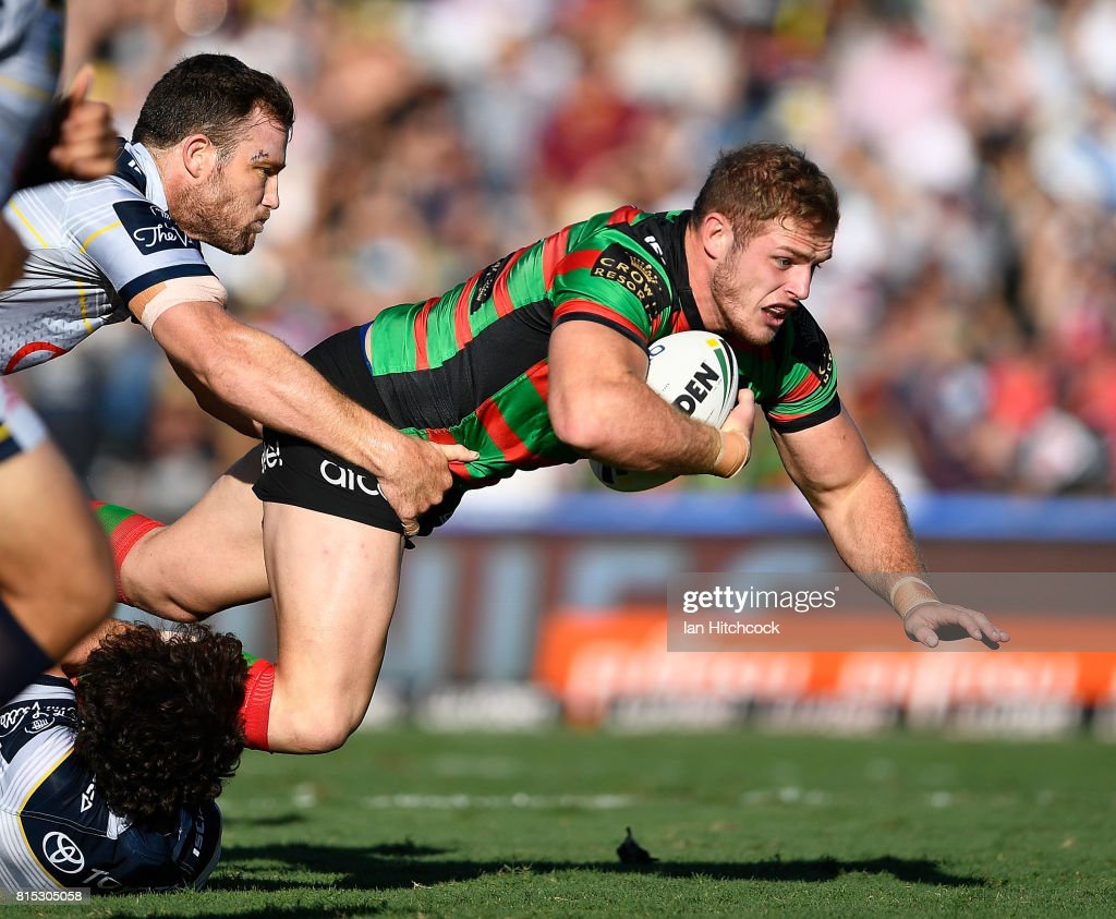 Tom Burgess of the Rabbitohs is tackled by Gavin Cooper of the Cowboys during the round 19 NRL match between the South Sydney Rabbitohs and the North Queensland Cowboys at Barlow Park on July 16, 2017 in Cairns, Australia.