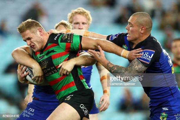 Tom Burgess of the Rabbitohs is tackled during the round 23 NRL match between the South Sydney Rabbitohs and the Canterbury Bulldogs at ANZ Stadium...
