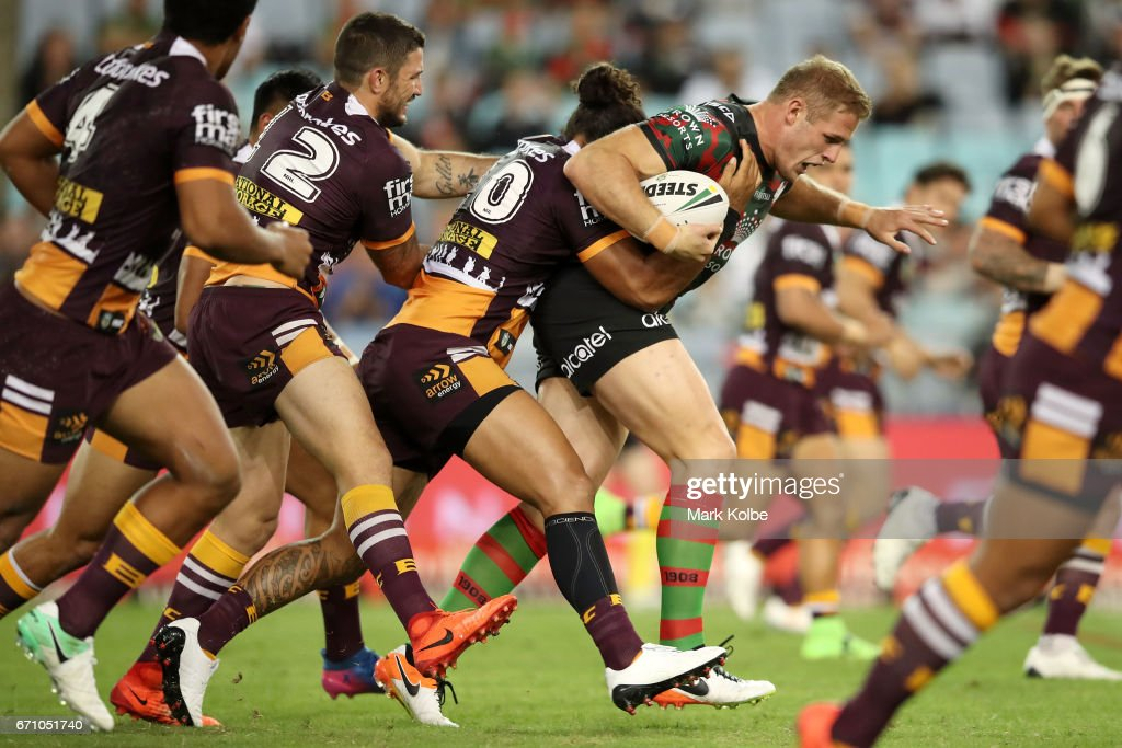 Tom Burgess of the Rabbitohs is tackled during the round eight NRL match between the South Sydney Rabbitohs and the Brisbane Broncos at ANZ Stadium on April 21, 2017 in Sydney, Australia.