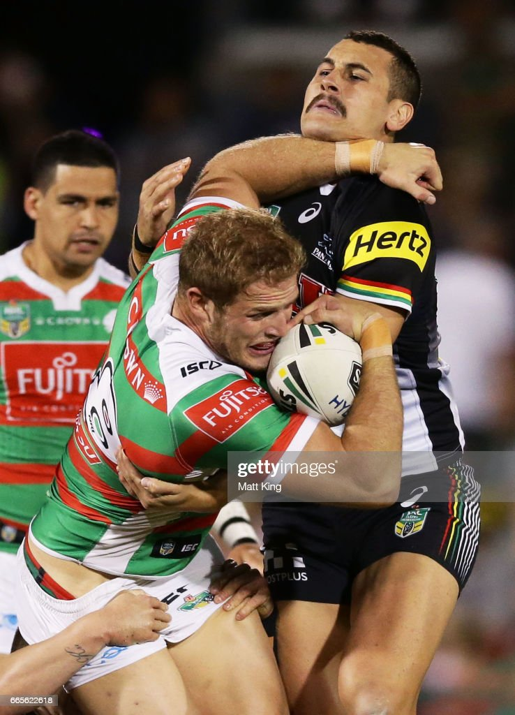Tom Burgess of the Rabbitohs is tackled during the round six NRL match between the Penrith Panthers and the South Sydney Rabbitohs at Pepper Stadium on April 7, 2017 in Sydney, Australia.