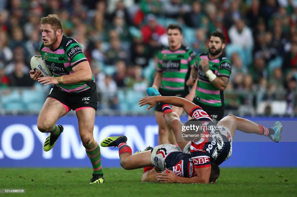 Tom Burgess of the Rabbitohs makes a break during the round 22 NRL match between the South Sydney Rabbitohs and the Sydney Roosters at ANZ Stadium on August 10, 2018 in Sydney, Australia.