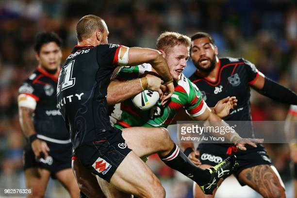 Tom Burgess of the Rabbitohs on the charge against Simon Mannering of the Warriors during the round 12 NRL match between the New Zealand Warriors and...