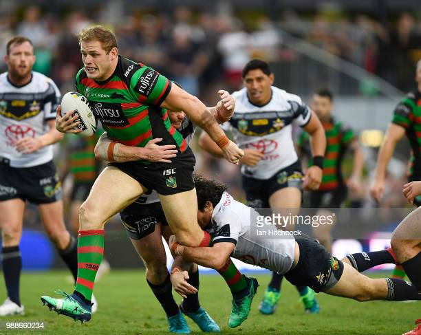 Tom Burgess of the Rabbitohs runs the ball during the round 16 NRL match between the South Sydney Rabbitohs and the North Queensland Cowboys at...