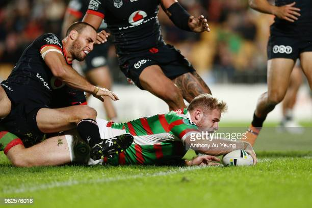 Tom Burgess of the Rabbitohs scores a try during the round 12 NRL match between the New Zealand Warriors and the South Sydney Rabbitohs at Mt Smart...