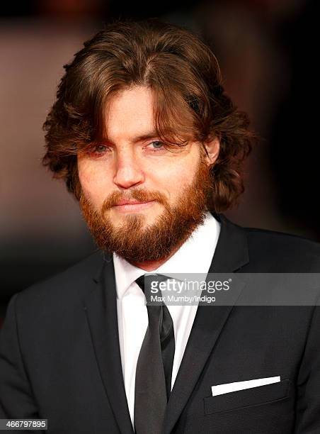 Tom Burke attends the UK Premiere of 'The Invisible Woman' at Odeon Kensington on January 27 2014 in London England