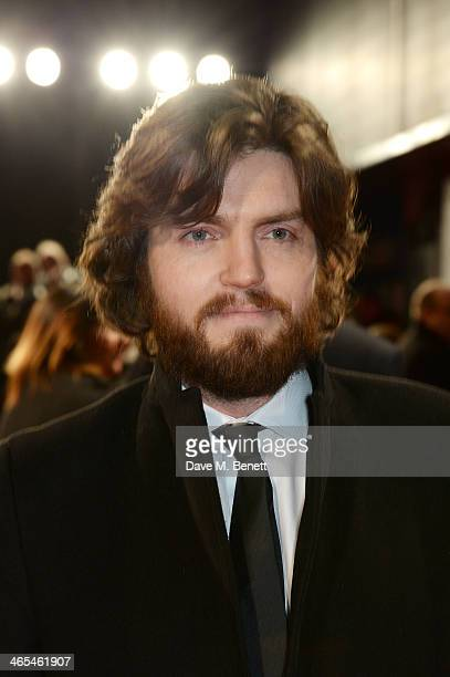 Tom Burke attends the UK Premiere of 'The Invisible Woman' at the ODEON Kensington on January 27 2014 in London England
