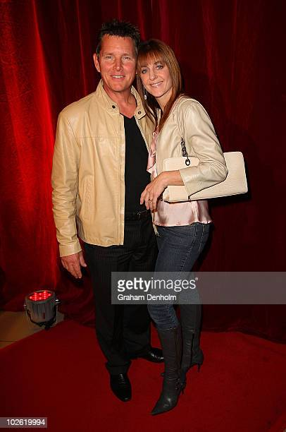 Tom Burlinson and wife Mandy Carnie arrive for the opening night of West Side Story at Star City on July 4 2010 in Sydney Australia