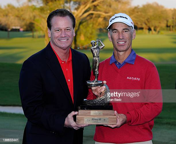 Tom Burns Chief Distribution Officer for Allianz and Covey Pavin pose with the winner's trophy after the final round of the Allianz Championship at...
