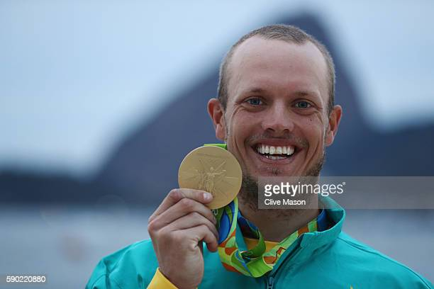 Tom Burton of Australia celebrates winning the gold medal in the Men's Laser class on Day 11 of the Rio 2016 Olympic Games at the Marina da Gloria on...