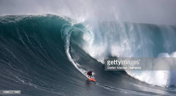 Tom Butler of Great Britain rides a big wave on December 10 2016 in Nazare Portugal