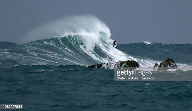 Tom Butler of Great Britain rides a big wave on December 12 2018 in Nazare Portugal