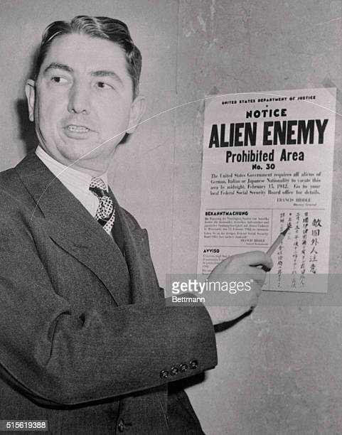 Tom C Clark coordinator of the Alien Enemy Control program of the Western Defense Command as he pointed to the first warning card to be posted in the...