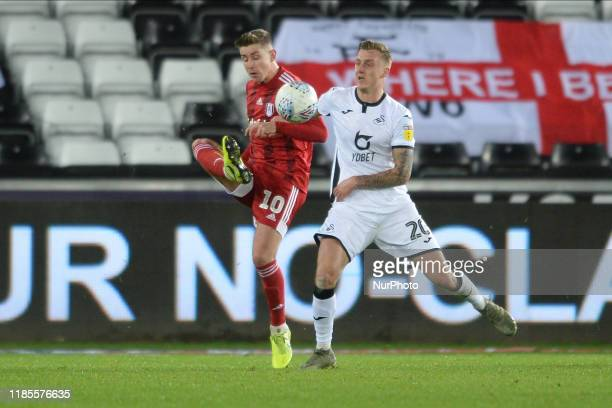 Tom Cairney and Ben Wilmot of Swansea City battle during the Sky Bet Championship match between Swansea City and Fulham at the Liberty Stadium...
