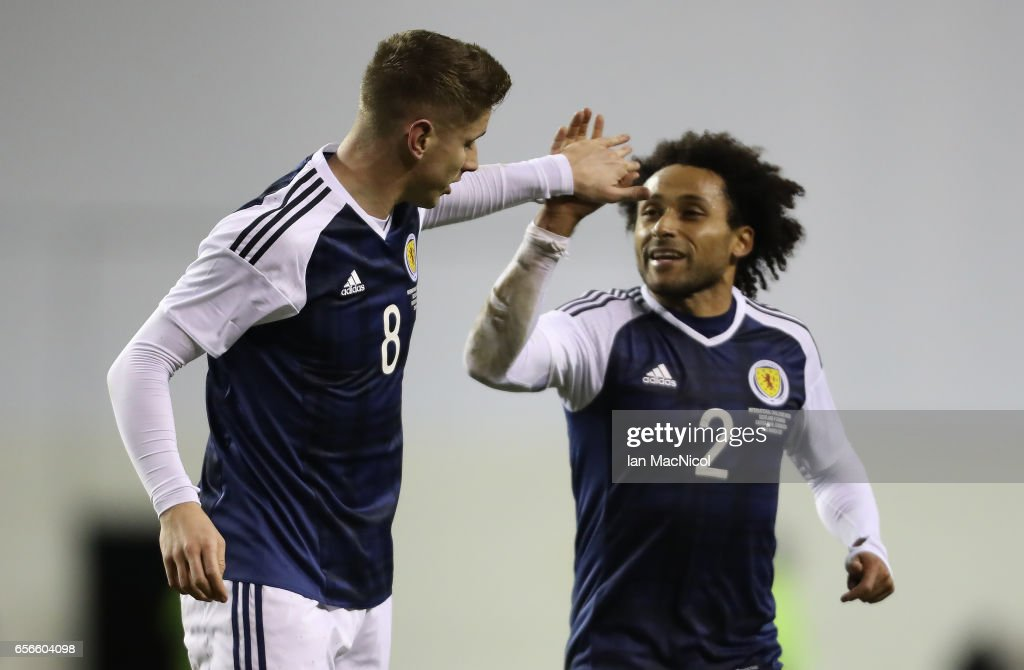 Tom Cairney and Ikechi Anya of Scotland celebrates scotlands' only goal during the International Challenge Match between Scotland and Canada at Easter Road on March 22, 2017 in Edinburgh, Scotland.