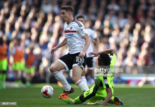 Tom Cairney of Fulham and Jordan Obita of Reading battle for possession during the Sky Bet Championship Play off semi final 1st leg match between...
