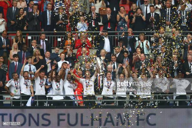 Tom Cairney of Fulham and Kevin McDonald of Fulham lift the trophy following their sides victory in the Sky Bet Championship Play Off Final between...