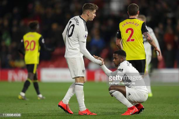 Tom Cairney of Fulham and Ryan Sessegnon of Fulham look dejected as their team are relegated due to the result in the Premier League match between...