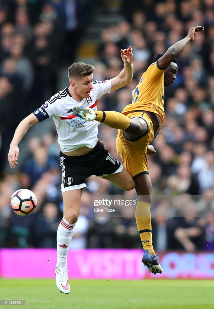 Tom Cairney of Fulham and Victor Wanyama of Tottenham Hotspur jump for the ball during The Emirates FA Cup Fifth Round match between Fulham and Tottenham Hotspur at Craven Cottage on February 19, 2017 in London, England.