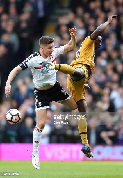 Tom Cairney of Fulham and Victor Wanyama of Tottenham Hotspur jump for the ball during The Emirates FA Cup Fifth Round match between Fulham and...