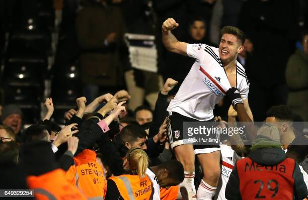 Tom Cairney of Fulham celebrates after scoring his sides first goal during the Sky Bet Championship match between Fulham and Leeds United at Craven...