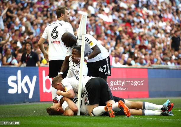 Tom Cairney of Fulham celebrates after scoring his sides first goal with his team mates during the Sky Bet Championship Play Off Final between Aston...