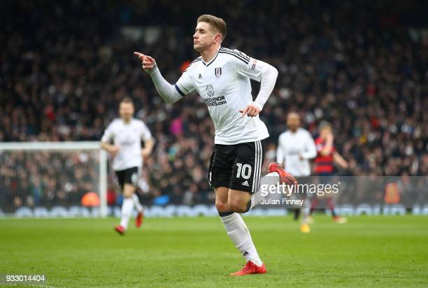 Tom Cairney of Fulham celebrates scoring his side's first goal during the Sky Bet Championship match between Fulham and Queens Park Rangers at Craven...