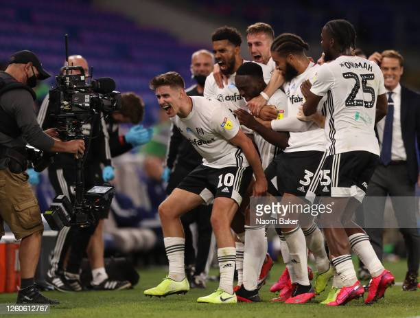 Tom Cairney of Fulham celebrates team mate Neeskens Kebano scoring his sides second goal infront of the TV camera during the Sky Bet Championship...
