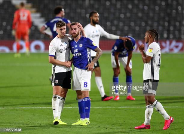 Tom Cairney of Fulham embraces Joe Ralls of Cardiff City during the Sky Bet Championship Play Off Semi-final 2nd Leg match between Fulham and Cardiff...