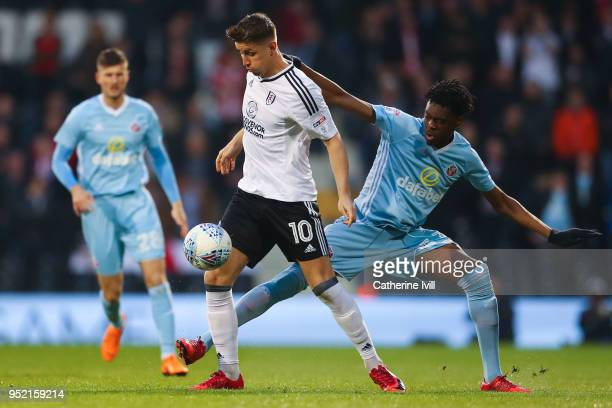 Tom Cairney of Fulham FC competes for the ball with Ovie Ejaria of Sunderland during the Sky Bet Championship match between Fulham and Sunderland at...