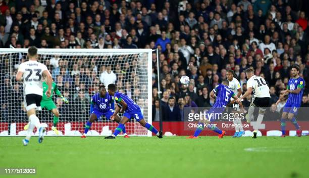 Tom Cairney of Fulham FC scores his teams second goal during the Sky Bet Championship match between Fulham and Wigan Athletic at Craven Cottage on...