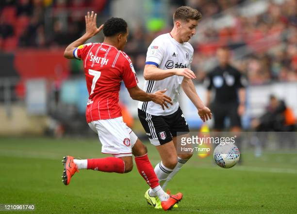Tom Cairney of Fulham is challenged by Korey Smith of Bristol City during the Sky Bet Championship match between Bristol City and Fulham FC at Ashton...