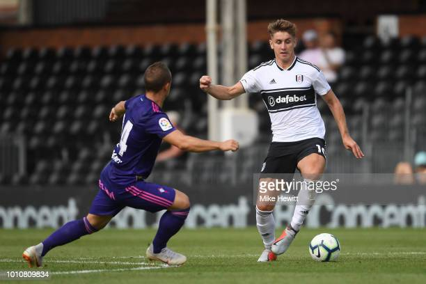 Tom Cairney of Fulham is challenged by Stanislav Lobotka of Celta Vigo during a PreSeason Friendly between Fulham and Celta Vigo at Craven Cottage on...