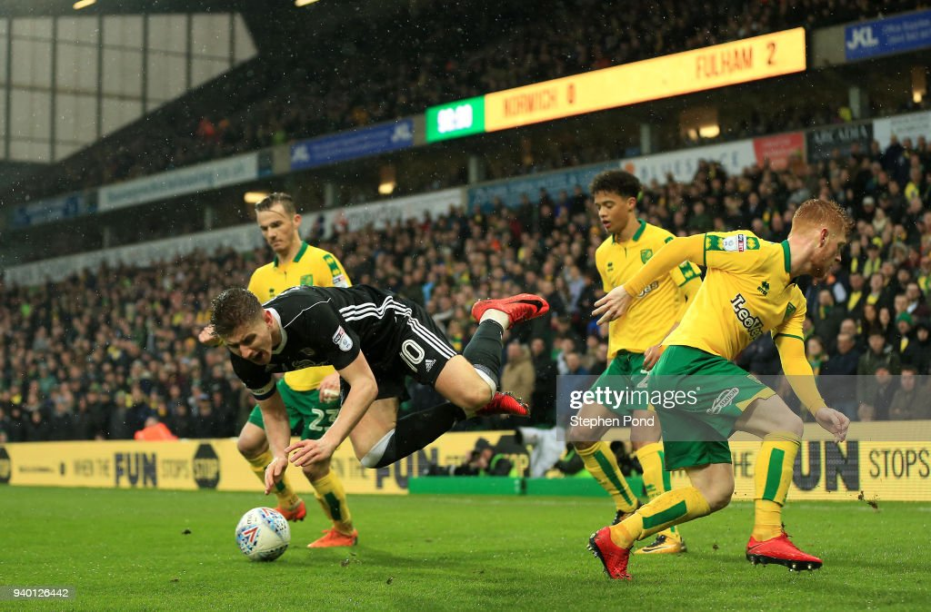 Tom Cairney of Fulham is fouled by Harrison Reed of Norwich City during the Sky Bet Championship match between Norwich City and Fulham at Carrow Road on March 30, 2018 in Norwich, England.