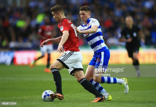 Tom Cairney of Fulham is put under pressure from Chris Gunter of Reading during the Sky Bet Championship Play Off Second Leg match between Reading...