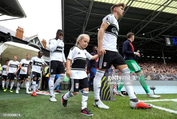 Tom Cairney of Fulham leads his team out prior to the Premier League match between Fulham FC and Crystal Palace at Craven Cottage on August 11 2018...