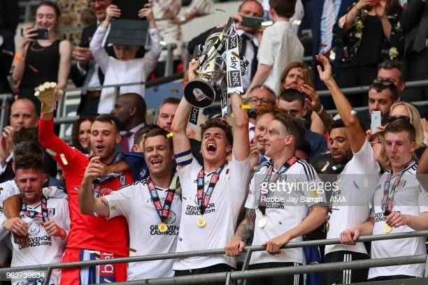 Tom Cairney of Fulham lifts the Sky Bet Championship play off trophy with his team mates during the Sky Bet Championship Play Off Final between Aston...