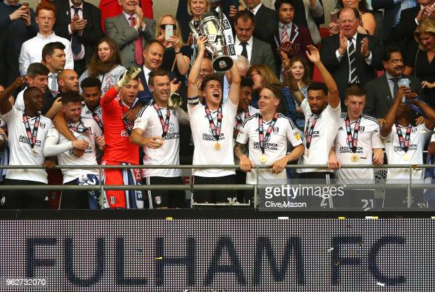 Tom Cairney of Fulham lifts the trophy following his sides victory in the Sky Bet Championship Play Off Final between Aston Villa and Fulham at...
