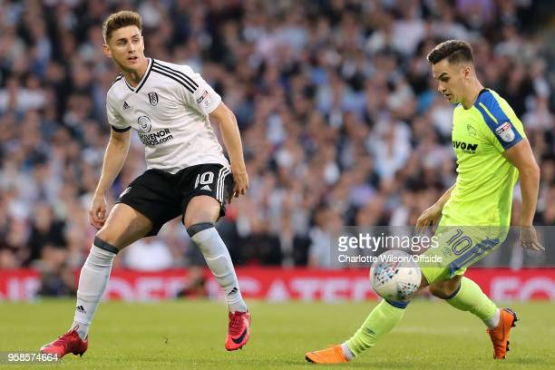 Tom Cairney of Fulham puts the ball past Tom Lawrence of Derby during the Sky Bet Championship Play Off Semi FinalSecond Leg match between Fulham and...