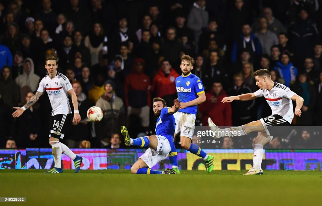 Tom Cairney of Fulham (R) scores their first and equalising goal during the Sky Bet Championship match between Fulham and Leeds United at Craven Cottage on March 7, 2017 in London, England.