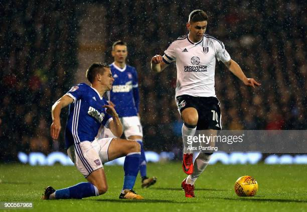 Tom Cairney of Fulham skips past Cole Skuse of Ipswich during the Sky Bet Championship match between Fulham and Ipswich Town at Craven Cottage on...