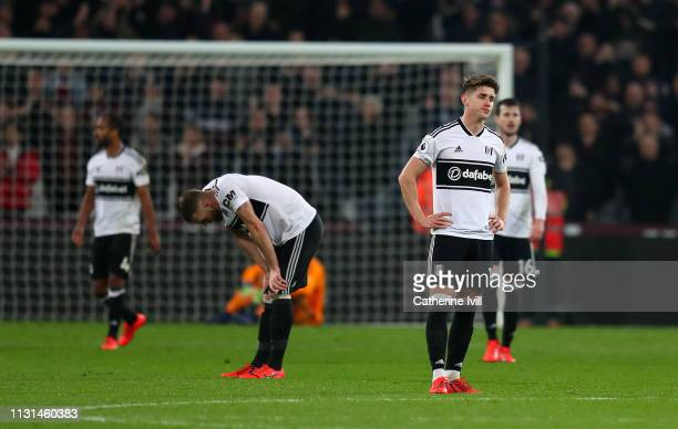 Tom Cairney of Fulham stands dejected after his side concede a third goal during the Premier League match between West Ham United and Fulham FC at...